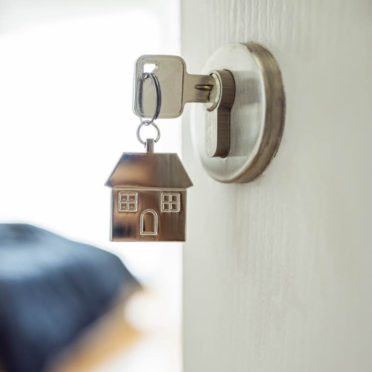 key in lock with house-shaped keychain