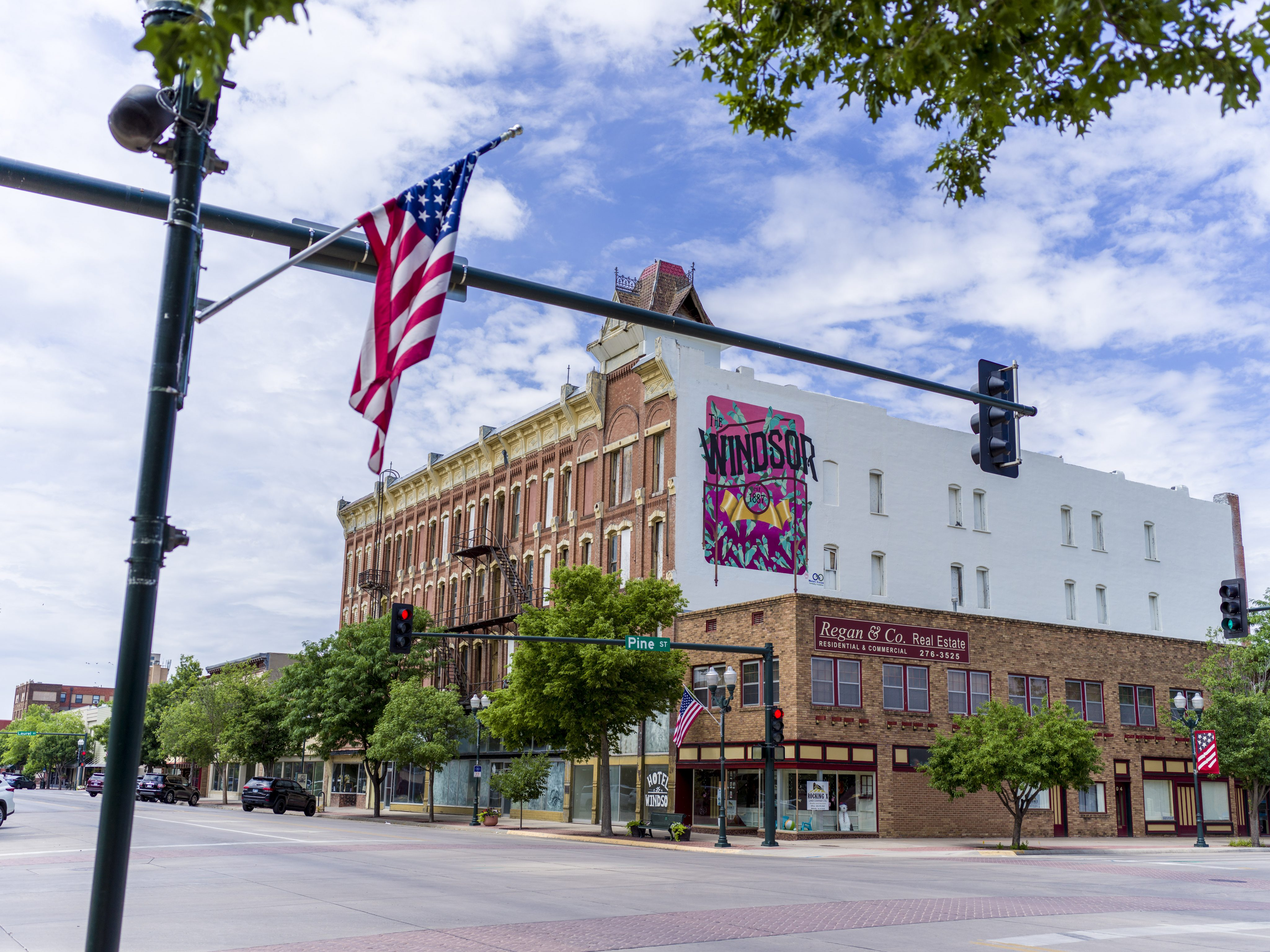 Historic Windsor Hotel located in Garden City, Kansas with blue sky and American flag